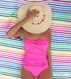 $109 Twist Front Bandeau One-Piece Pink One-Piece Bandeau Swimsuit Teamed With A Pompom Straw Hat