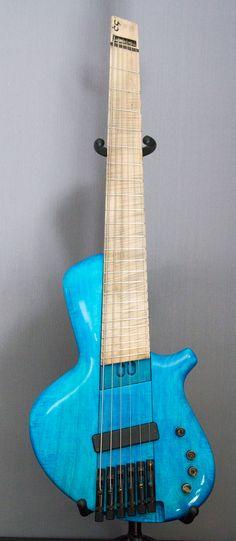UbiQ : 6 strings bass, shortscale (815 - 785mm) fanned fret. ABM tuners, Noll tcm3 preamp. www;cg-lutherie.net