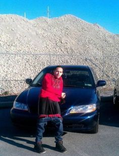 Nothing says cool like leaning up against your car with your pants down by your knees.