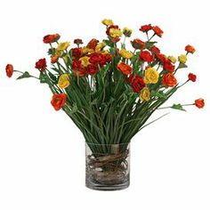 """Faux ranunculus arrangement with vine-inspired accents.    Product: Faux floral arrangementConstruction Material: Silk and glassColor: Yellow, orange and greenFeatures: Includes faux ranunculusDimensions: 17"""" H x 14"""" Diameter Note: Suitable for indoor use only"""