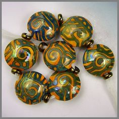 a set of seven bright apricot handmade lampwork by PolychromeBeads