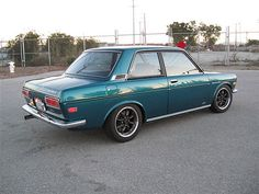 Datsun 510  An ex brother in law used to have nearly this same color.  A little more evergreeny.  With gold Enkie webs and a luggage rack it actually looked a bit better than this