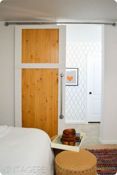 HOW TO BUILD A SIMPLE SLIDING BARN DOOR Check out the hardware.Uses pipe and pipe accessories. vintagerevivals.com