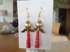 Paper beads angel earrings by MagdaCrafts on Etsy, £8.50