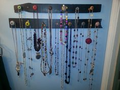 Made my own necklace holder with scrap wood, spray paint, and decorative knobs. Craft #2