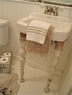 add some old legs to a suspended sink. finally, a way to dress up those ugly things.