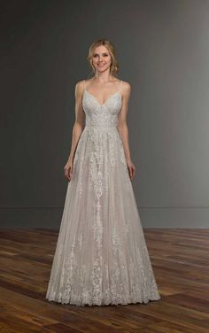 A dreamy style, this soft, boho A-line wedding dress from Martina Liana is the epitome of feminine, bohemian fashion. French lace adorns the bodice of this gown, accentuated perfectly with a V-neckline and shoestring straps. Illusion Neckline Wedding Dress, Wedding Dress Necklines, Wedding Dress Sizes, Vows Bridal, Bridal Gowns, Wedding Dress Gallery, Designer Wedding Gowns, Dream Dress, Bridal Style