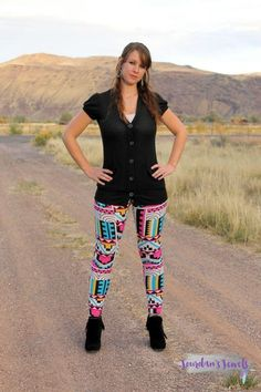 Black Button Cardigan paired with multi color aztec printed leggings and black fringe booties. Shop this look at Jourdan's Jewels. Country Girls Outfits, Country Girl Style, Cowgirl Outfits, Cowgirl Clothing, Cowgirl Fashion, Black Cardigan Outfit, Cardigan Outfits, Aztec Leggings, Printed Leggings