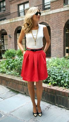 Bright skirt offset with a white top, plus a gold necklace and a gold pointy toe shoe for a professional look with a bit of personality.