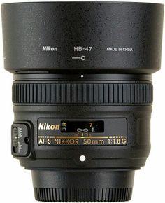 Fifty mil lens, best buy ever. I love prime lenses!  Nikon 50mm 1.8G