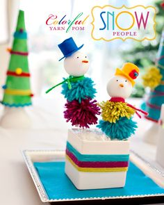 Yarn Pom Snow People - A colorful craft that breaks tradition. Place a few on your mantel to brighten up your decor. #tutorial