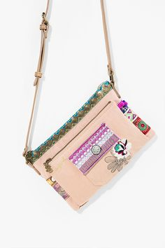 This Desigual Boho shoulder bag is so thin and comfortable that you'll forget you're wearing it.