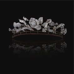 A Rose, a Thistle and a Shamrock Spray Diamond Tiara, each representing 1 of the 3 Kingdoms of Great Britain. The center rose is set en tremblent and the tiara breaks down into five separate brooches with provided settings. Early 19th century.  From the Estate of Lady Hesketh Christian. (Photo Sotheby's 2007)