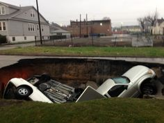 A sinkhole swallowed three cars in the South Deering neighborhood on the Southeast Side of Chicago early this morning. What more will it take for the city to fix these pot holes?