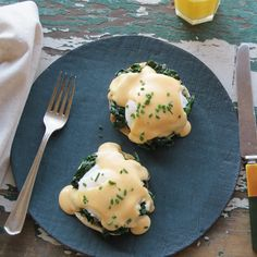 This recipe for eggs Florentine is based on eggs Benedict: Poached eggs rest on toasted English muffins and a bed of garlicky spinach, topped with a light cheese sauce.