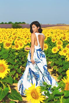 Blue & white maxi dress in a sunflower field