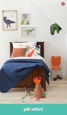 Create a cut dinosaur kid room with this Pillowfort dinosaur decor from Target. Cool Dino print bedding and Dino wall art to create a Creature Cave kid room. (aff)