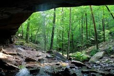 View of Glory Hole Falls from behind the waterfall, inside the overhang cave