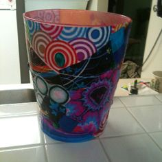 Turn an ordinary plastic trash can into a work of art! Great for a kids room.    Clean trash can. Cut or tear various shapes and sizes of patterned paper (gift wrap, scrap paper, or even printer paper with cool printed designs work great). Using modge podge or spray on adhesive, affix the paper onto trash can, overlapping edges. Cover entire surface with modge podge once finished for a shiny, protected surface. Allow to dry for 15-20 minutes. Attach jewels or other decorations, for extra…