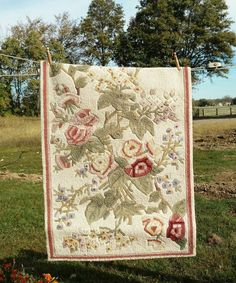 Check out this item in my Etsy shop https://www.etsy.com/listing/474343604/vintage-red-rose-hooked-wool-rug-antique