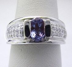 Ladies' 1.20 Carat Total 7x5mm Oval Tanzanite and Diamond Ring in 14K White Gold  http://www.ebay.com/itm/251017451699?ssPageName=STRK:MESELX:IT&_trksid=p3984.m1586.l2649    www.americanjewelryinc.com