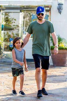 Scott Disick with son Mason Disick in kids' Nike Roshe Run sneakers.