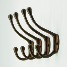 100  Rustic Coat Hooks! Discover the best farmhouse themed coat hooks and country coat racks for your home. Your farmhouse entryway need coat hooks and coat racks so you can hang hats, backpacks, keys, coats, and more. Hat Hooks, Towel Hooks, Rustic Walls, Wooden Walls, Hang Hats, Rustic Coat Hooks, Cast Iron Coat Hooks, Metal Shelving Units, Frame Shelf
