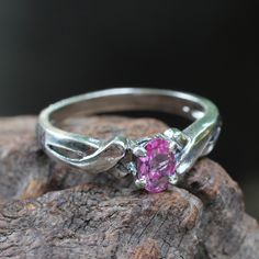Twisted silver ring with spinal gemstone