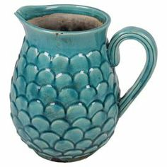 "Showcasing a scaled design and classic silhouette, this ceramic pitcher is perfect for displaying vibrant blooms in the entryway or willow branches in your den.   Product: PitcherConstruction Material: CeramicColor: BlueDimensions:Small: 9.5"" H x 9"" W x 7.5"" DLarge: 11.5"" H x 10"" W x 8.5"" D"