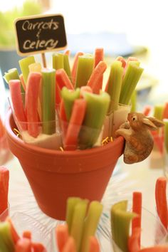 Peter Rabbit themed shower. Carrots and celery in ranch, in cups bought at Party City, then placed in a flower pot.