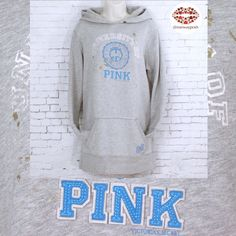 """VS PINK LONG HOODIE/TUNIC Heather grey Victoria's Secret hoodie. It's 32"""" so it works with leggings as a tunic. Kangaroo front pocket, gold splashes of """"paint"""", """"university of pink"""" (white, worn- in looking), felted embroiled """"PINK"""" and """"VS Pink"""" logo in the center. There is also """"86"""" on left side of the pocket. Double fabric hoodie (no drawstring, never been one). Excellent condition. Size:S. Measurements: length 32"""". Armpit to armpit: 21"""". Hip( side to side): 19"""". Tts. ‼No TRADES!! PINK…"""