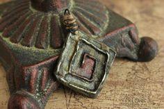 Handmade Hand Cast Tribal Spiral Pendant by Etinifni Creations, $20.00  zinc - copper - hand-cast - metalwork - jewelry