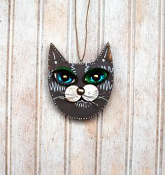 Hey, I found this really awesome Etsy listing at https://www.etsy.com/listing/214171411/cat-ornament-recycled-hand-made-cat