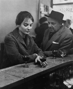At the Café, Chez Fraysse, Rue de Seine, Paris 1958 by Robert Doisneau