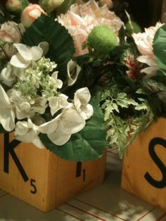 Scrabble center pieces that says K.I.S.S.