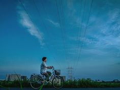 Human Powered While walking with his camera on an elevated jogging and biking trail beside the Tama River in Tokyo Your Shot member Danilo Dungo paused beneath rows of power lines that had caught his interest. Wanting to use the scene he waited for a subj