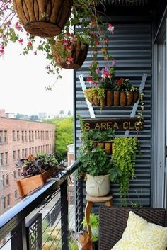 Small balcony garden a small balcony garden utilizing overhead and wall space small balcony garden design . House With Balcony, Small Balcony Decor, Small Balcony Garden, Small Balcony Design, Small Patio, Outdoor Balcony, Balcony Ideas, Patio Ideas, Balcony Grill