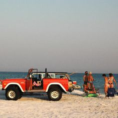 Bronco on the beach with friends. I would love to have one of these to cruise around santa monica with my pup. My younger brother has one in black.