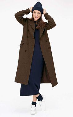 Manteau : armyManteau long kaki à double boutonnage, Monoprix, 50 % laine, 43 % polyester, 7 % autres fibres, 139,99 €.