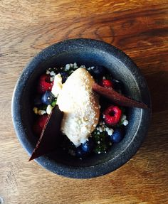 Parsley granita with fresh berries, white chocolate crumbs and caramel sorbet.