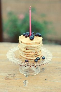 birthday pancakes! How cute would this be for a first birthday brunch party...especially if the birthday was in early summer. Or I could just make them for Sunday breakfast...who says birthday candles are only for birthdays?