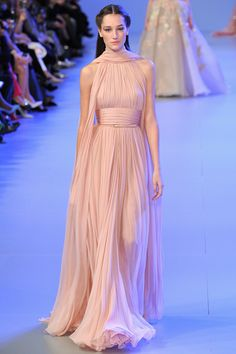 Elie Saab; Printemps 2014.  This dress intrigues me; it is a lovely, pale-pink silk column in the Grecian style, and yet very...accessible.  I like it.