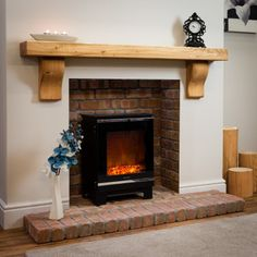 View our exclusive range of 18 solid rustic oak beams and wooden fireplace mantel shelves. Crafted in our UK workshop, delivery free of charge. Wooden Fireplace Surround, Wood Burner Fireplace, Fireplace Shelves, Mantel Shelf, Brick Fireplace, Fireplace Surrounds, Wooden Fire Surrounds, Floating Fireplace, Natural Gas Fireplace