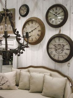 I Love The Idea Of A Clock Wall ~ There have been so many times I couldn't decide which clock I wanted to buy...now I can just buy all of them and do this!!