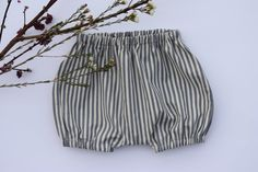 These gorgeous bloomers are made from top quality cotton and can be worn on their own in summer or with tights or leggings underneath during the cooler months. The pattern is lovely blue / grey and white stripe making it perfect for either a boy or a girl. Pattern by Brindille and Twig. Please visit my shop for other designs - https://www.etsy.com/shop/RainbowSparklesBlue?ref=hdr_shop_menu