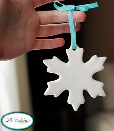 Snowflake ornaments using Crayola model magic and a cookie cutter. This is TOO easy! Looks awesome; I have to try this :)