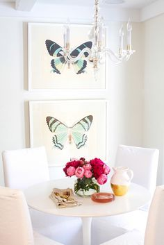 White kitchen with framed butterfly prints