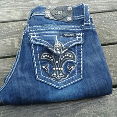 "Miss Me Fleur-de-lis  Boot Cut Bling jeans! Miss Me Fleur-de-lis boot cut Bling jeans! Black Fleur-de-lis with silver studs. Size 27, inseam 33"". Miss Me Jeans Boot Cut"