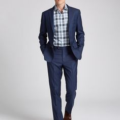 Navy is one of the easiest colors to wear. Here, we've added a tonal plaid shirt…