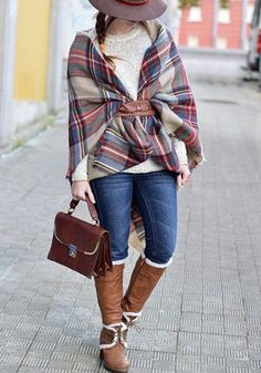 Full front of girl wrapped in a belted tartan plaid shawl